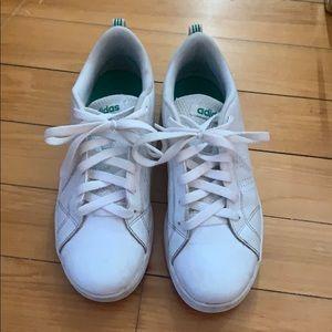 White adidas sneakers.